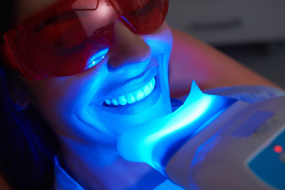 A patient receives professional teeth whitening at Summit Family & Cosmetic Dentistry