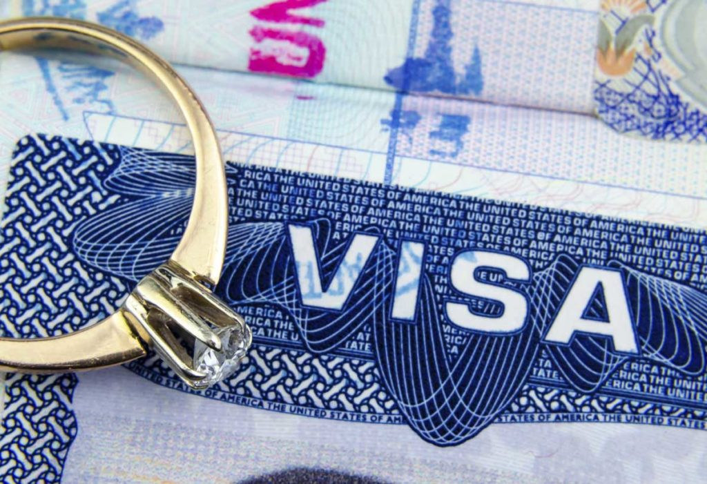 A client at Clearwater Law Group's marriage green card visa and their wedding ring.